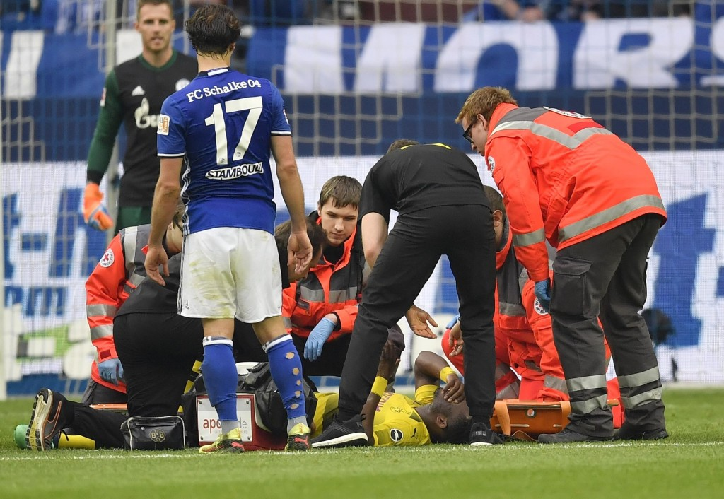 Dortmund's Michy Batshuayi lays on the pitch with an injury during the German Bundesliga soccer match between FC Schalke 04 and Borussia Dortmund in G