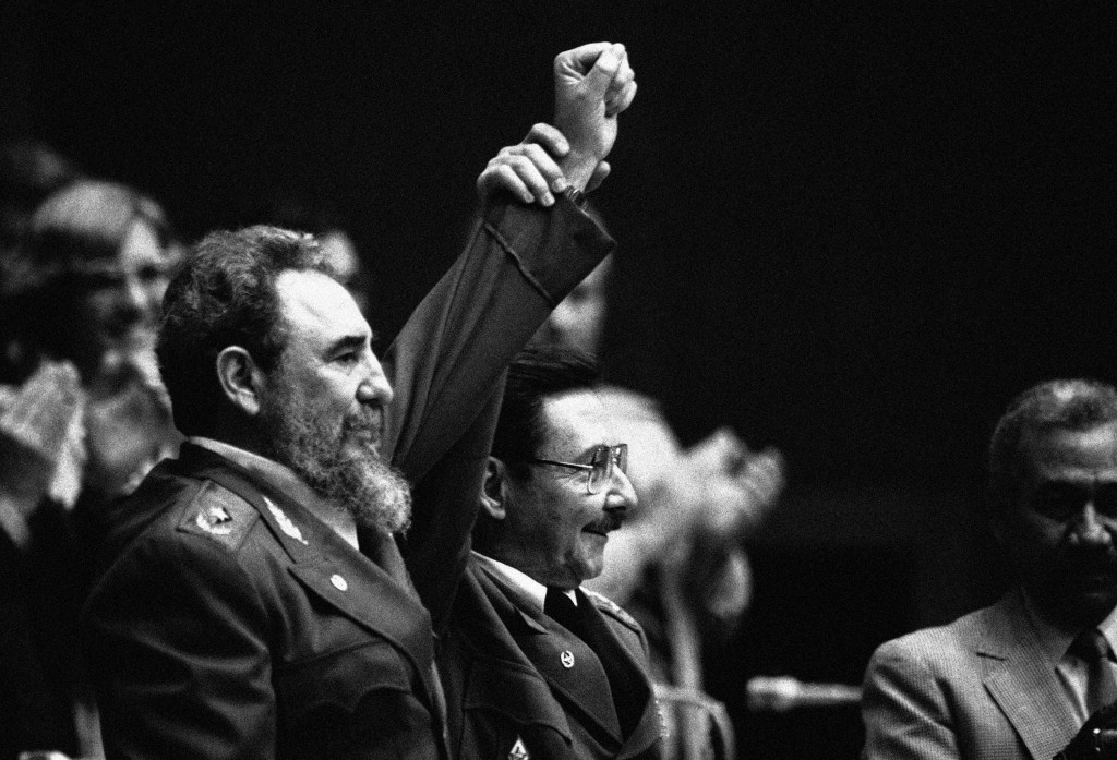 FILE - In this Feb. 8, 1986 file photo, Cuban President Fidel Castro, left, joins hands with his younger brother Raul Castro, chief of the Cuban Armed