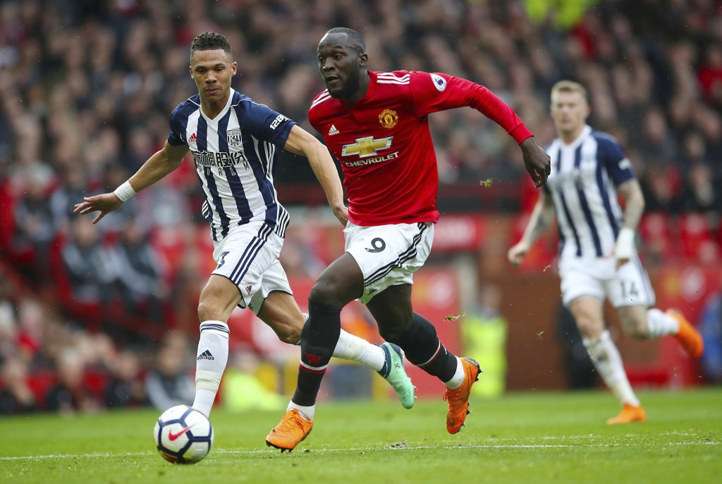 West Bromwich Albion's Kieran Gibbs, left, and Manchester United's Romelu Lukaku battle for the ball during the English Premier League soccer match at