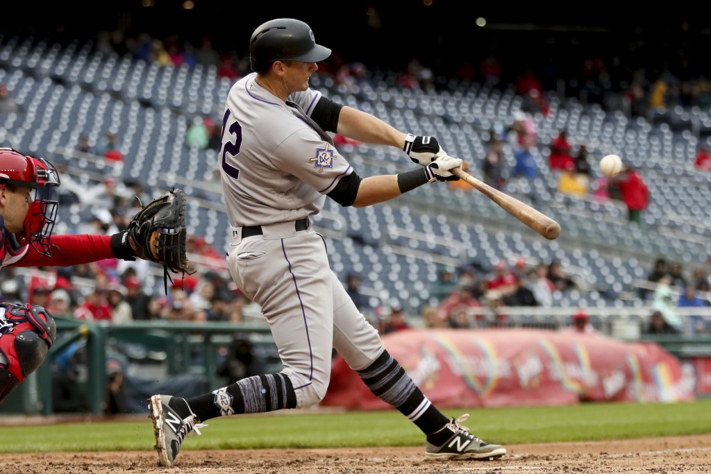 Colorado Rockies' DJ LeMahieu hits a home run during the eighth inning of a baseball game against the Washington Nationals at Nationals Park, Sunday,