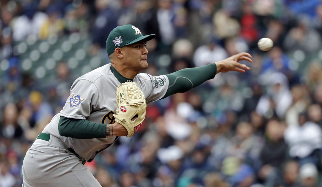 Oakland Athletics starting pitcher Sean Manaea throws against the Seattle Mariners in the first inning during a baseball game Sunday, April 15, 2018,