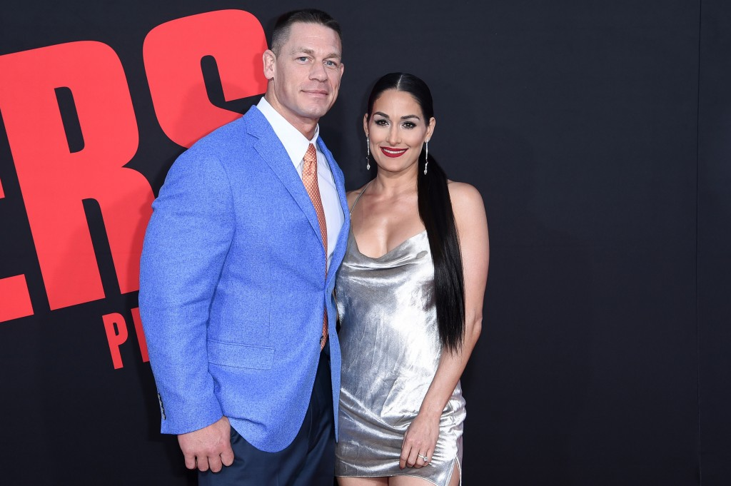 """In this Tuesday, April 3, 2018, photo, John Cena, left, and Nikki Bella attend the LA Premiere of """"Blockers"""" at the Regency Village Theatre in Los Ang"""