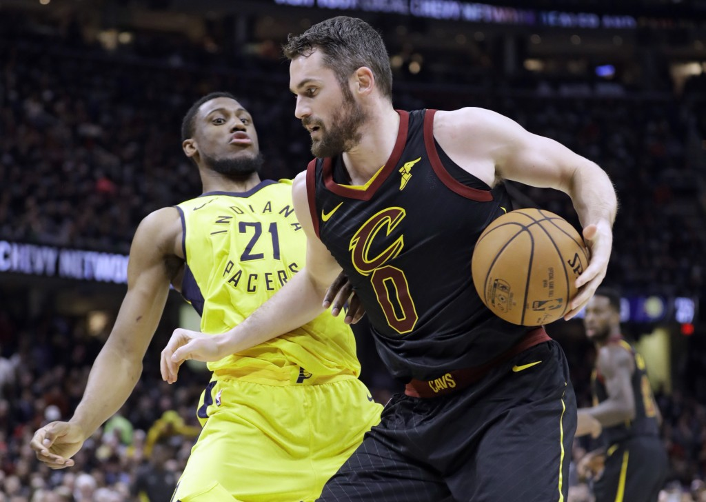 Cleveland Cavaliers' Kevin Love (0) drives to the basket against Indiana Pacers' Thaddeus Young (21) in the first half of a first-round playoff series