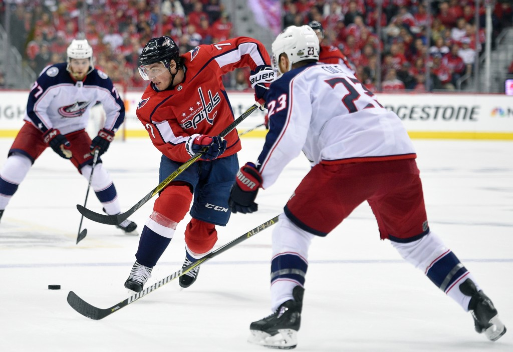 Washington Capitals right wing T.J. Oshie (77) chases the puck against Columbus Blue Jackets defenseman Ian Cole (23) during the second period in Game