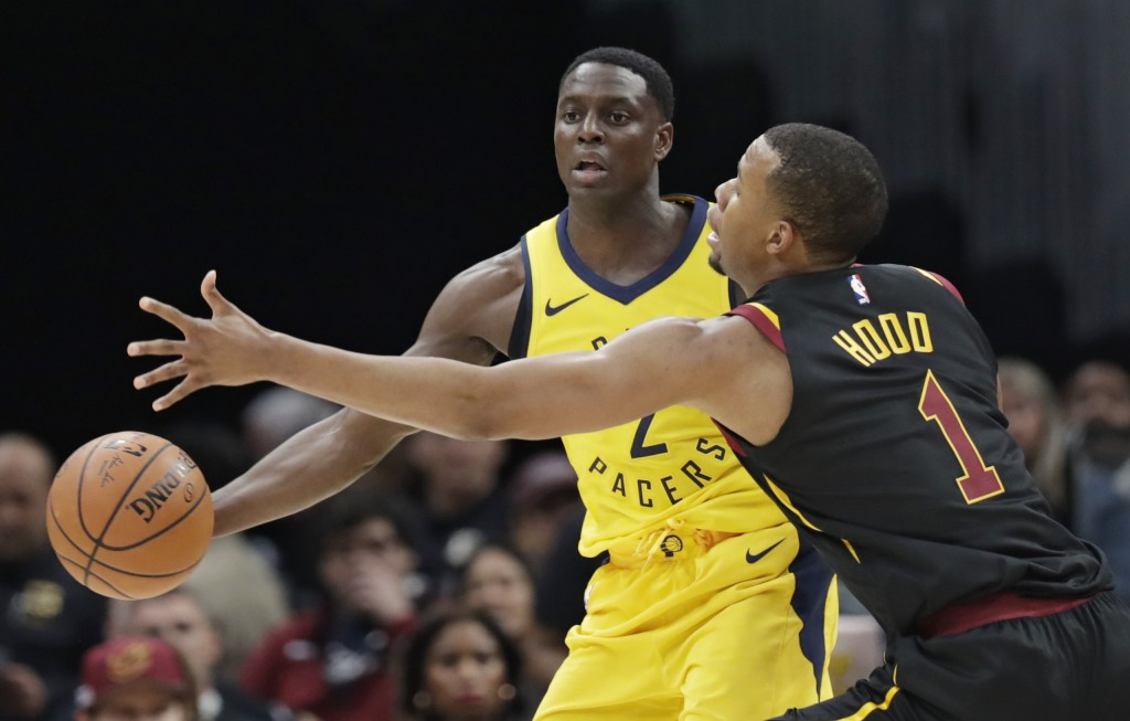 Indiana Pacers' Darren Collison (2) passes around Cleveland Cavaliers' Rodney Hood (1) in the first half of Game 1 of an NBA basketball first-round pl