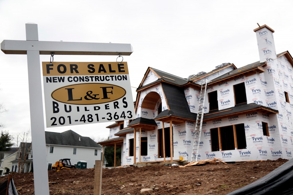 FILE- In this Feb. 26, 2018, file photo, an unfinished house is for sale in Franklin Lakes, N.J. On Tuesday, April 17, the Commerce Department reports
