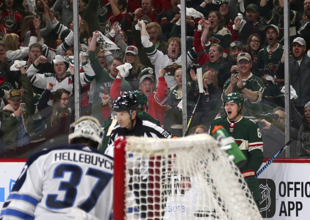 Minnesota Wild right wing Mikael Granlund (64) celebrates his goal on Winnipeg Jets goalie Connor Hellebuyck (37) in the first period of an NHL hockey