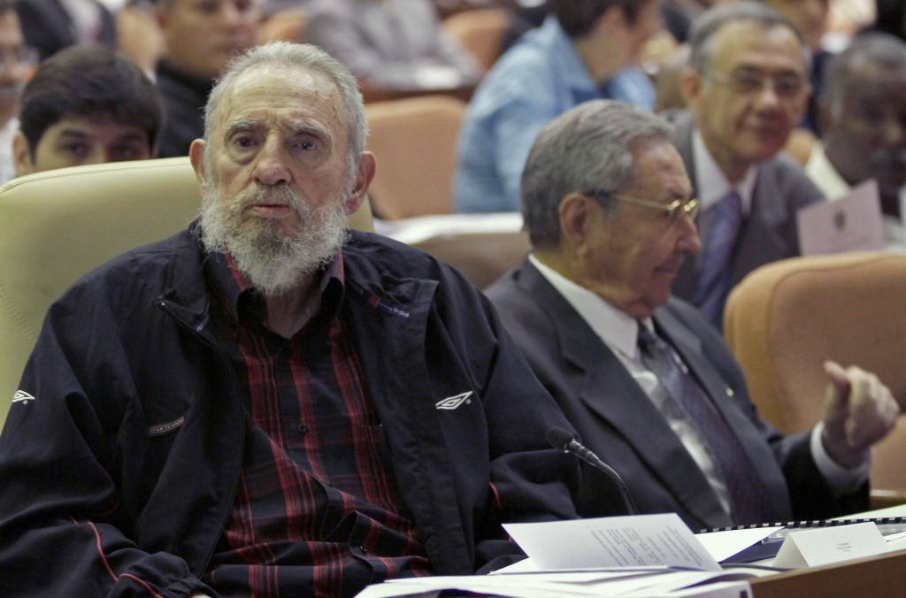 FILE - In this Feb. 24, 2012 file photo, Fidel Castro attends a National Assembly session in which his brother Cuba's President Raul Castro accepted a