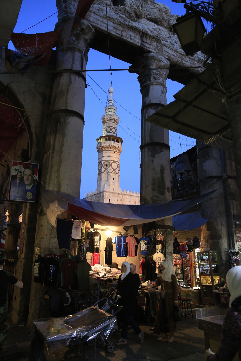 Woman shop at the Hamidiyeh Market that was named after the 34th Sultan of the Ottoman Empire Abdul Hamid II, in the Old City of Damascus, Syria, Sund