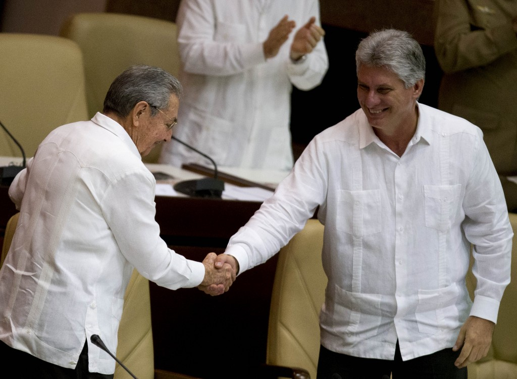 FILE - In this Dec. 20, 2014 file photo, Cuba's President Raul Castro, left, shakes hands with Vice President Miguel Diaz-Canel, at the closing of the