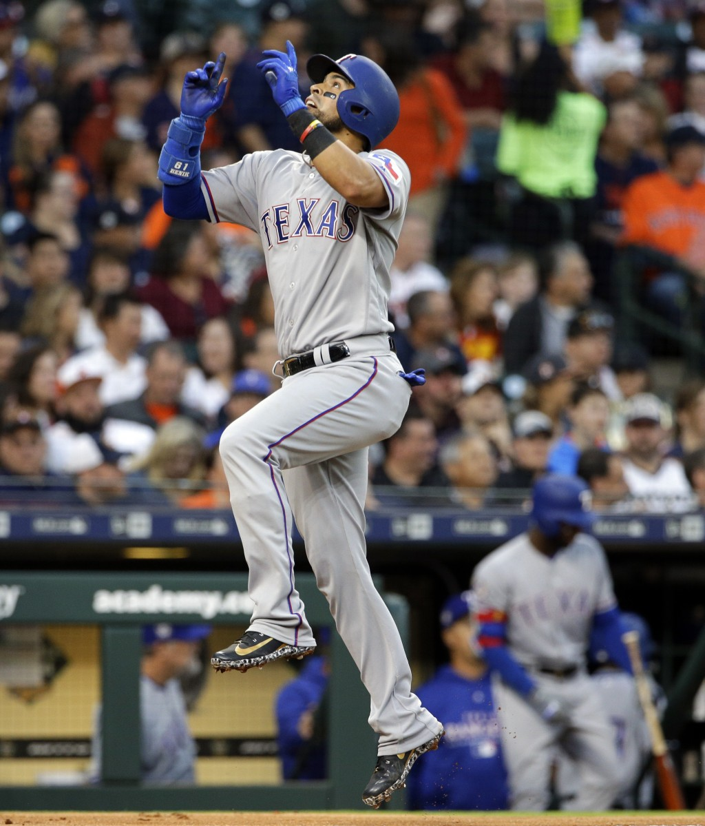 Texas Rangers Robinson Chirinos reacts as he crosses home plate after hitting a home run during the third inning of a baseball game against the Housto