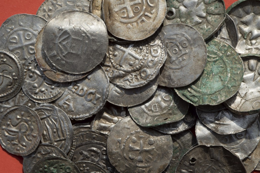 The April 13, 2018 photo shows medieval Saxonian, Ottoman, Danish and Byzantine coins after a medieval silver treasure had been found near Schaprode o