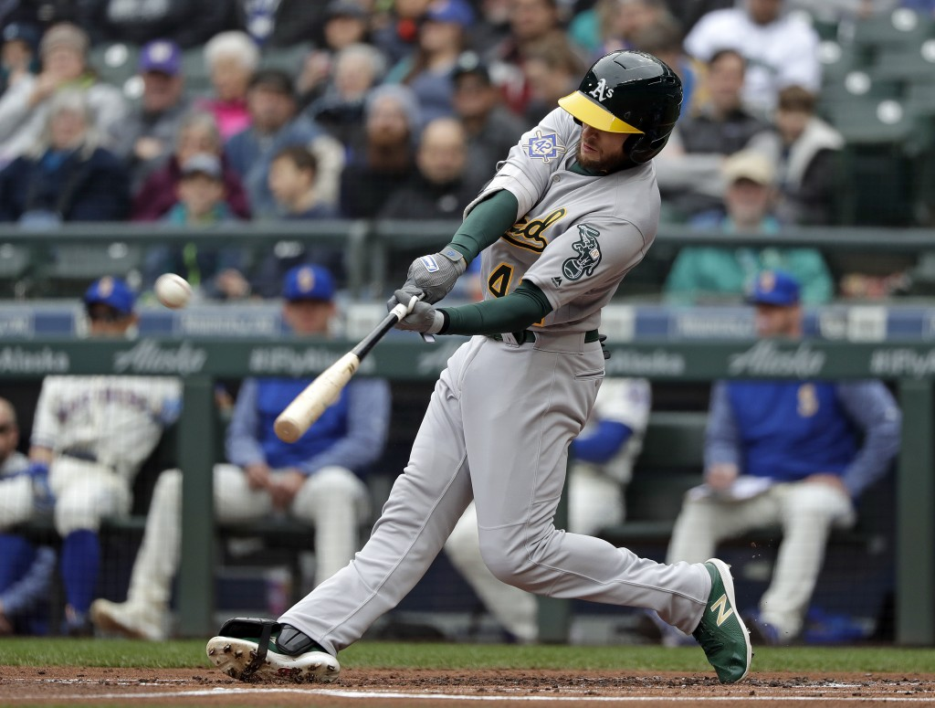 Oakland Athletics' Jed Lowrie connects for a two-run home run against the Seattle Mariners in the first inning during a baseball game Sunday, April 15