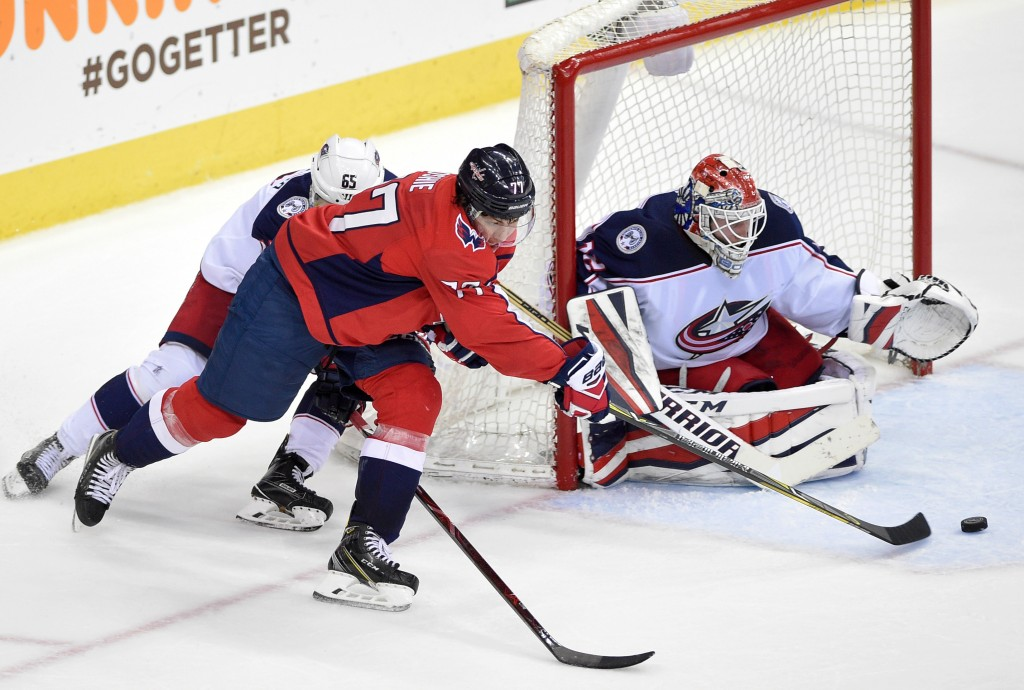 Washington Capitals right wing T.J. Oshie (77) skates with the puck in front of Columbus Blue Jackets goaltender Sergei Bobrovsky (72), of Russia, and