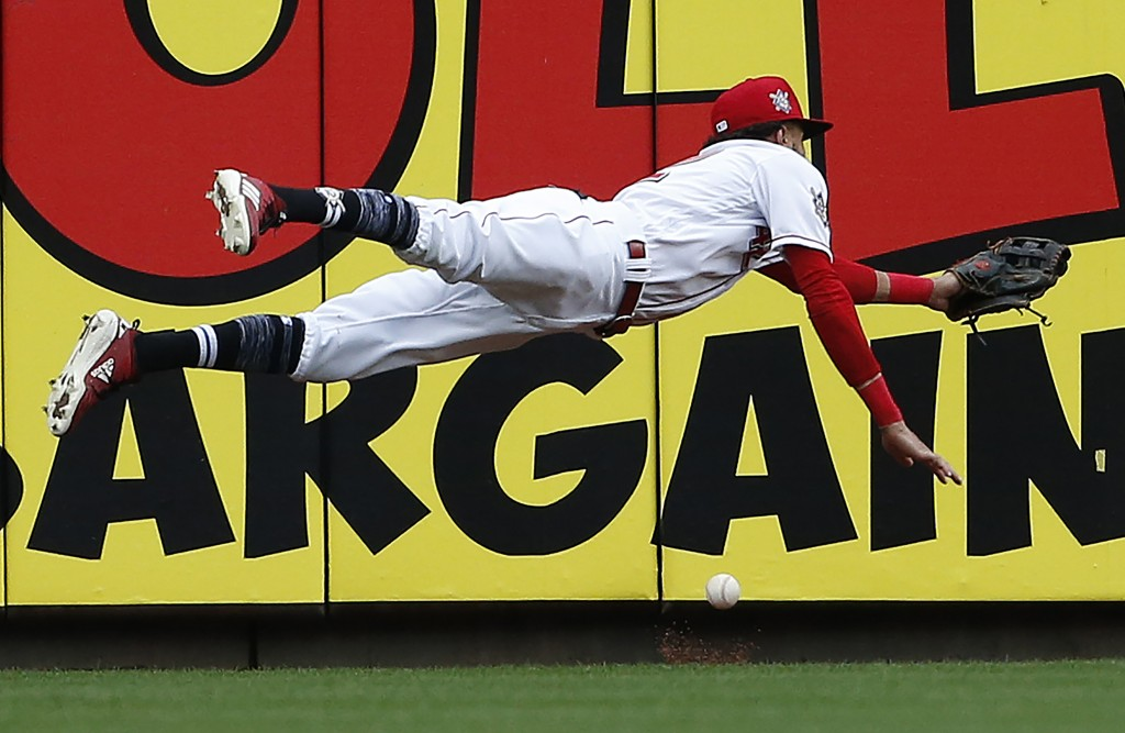 Cincinnati Reds center fielder Billy Hamilton dives for but cannot get to a double off the bat of St. Louis Cardinals' Jose Martinez during the sevent