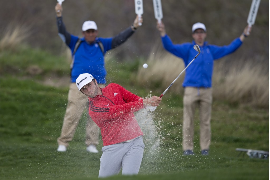 Spain's Jon Rahm chips out of a bunker on his way to winning the Spanish Open Golf tournament in Madrid, Spain, Sunday, April 15, 2018. (AP Photo/Paul
