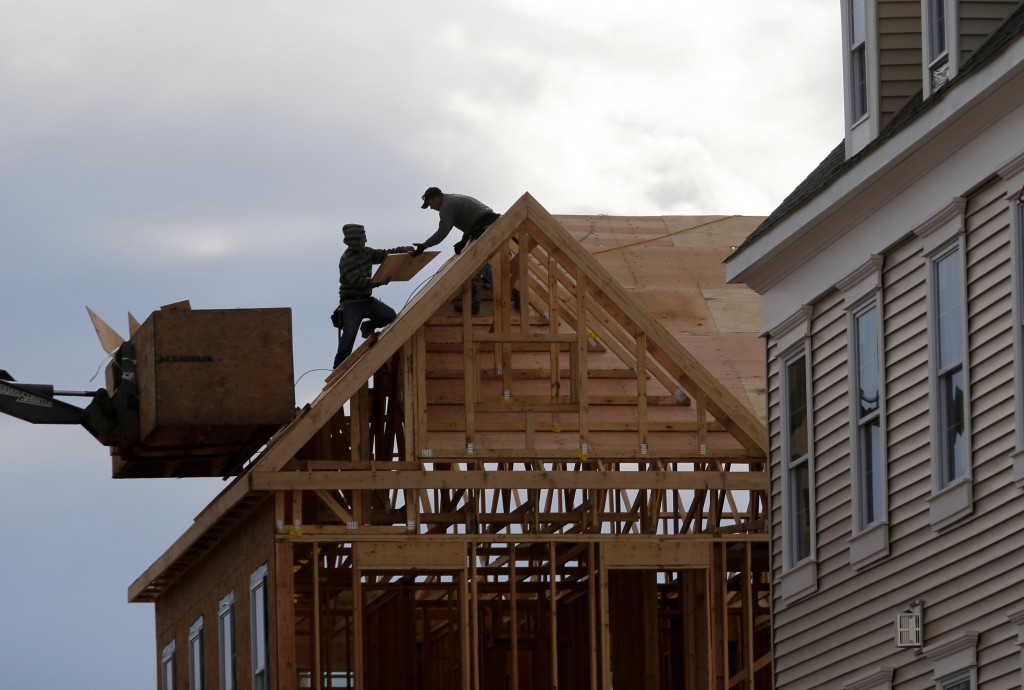 FILE- In this Feb. 26, 2018, photo, construction workers work on a new townhouse in Wood-Ridge, N.J. On Monday, April 16, the National Association of