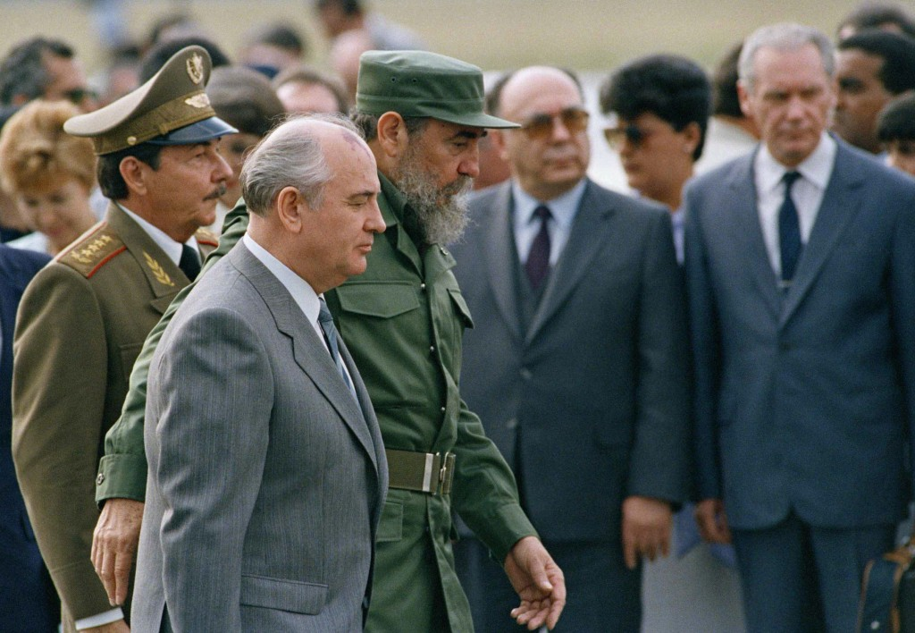 FILE - In this April 3, 1989 file photo, Cuban President Fidel Castro and his brother, Defense Minister Gen. Raul Castro, left, escort Soviet Union Pr