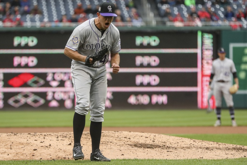 Colorado Rockies starting pitcher Tyler Anderson reacts after loading the bases in the fifth inning of a baseball game against the Washington National