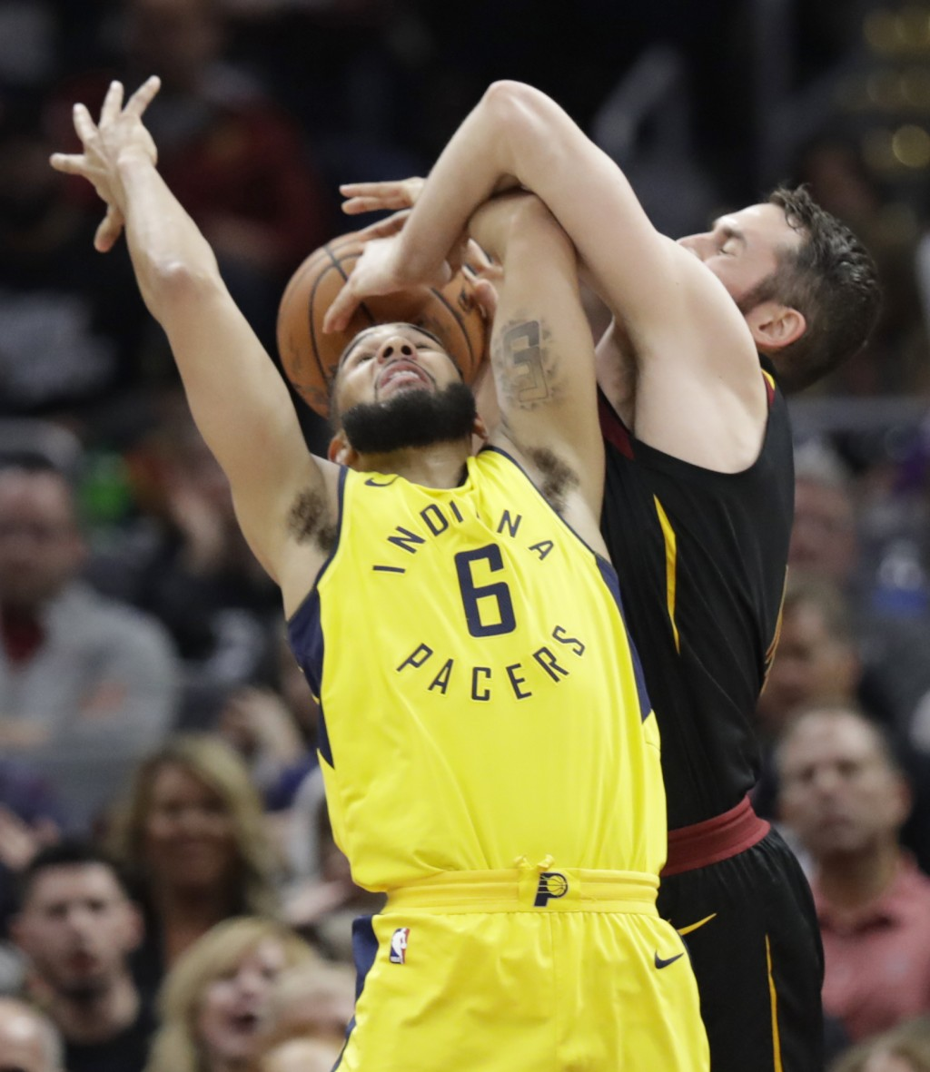 Indiana Pacers' Cory Joseph (6) and Cleveland Cavaliers' Kevin Love, right, battle for the ball in the first half of Game 1 of an NBA basketball first