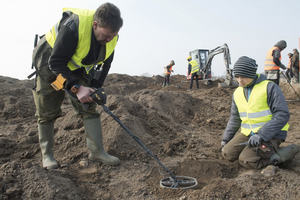 In this April 13, 2018 photo hobby archaeologist Rene Schoen and 13-year-old  Luca Malaschnitschenko, right, search for coins after a medieval silver