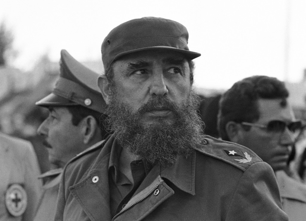 FILE - In this Nov. 2, 1983 file photo, Cuban President Fidel Castro and his brother Raul, head of the Cuban Armed Forces, watch as the first group of