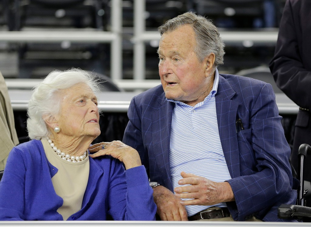 FILE - In this March 29, 2015, file photo, former President George H.W. Bush and his wife Barbara Bush, left, speak before a college basketball region