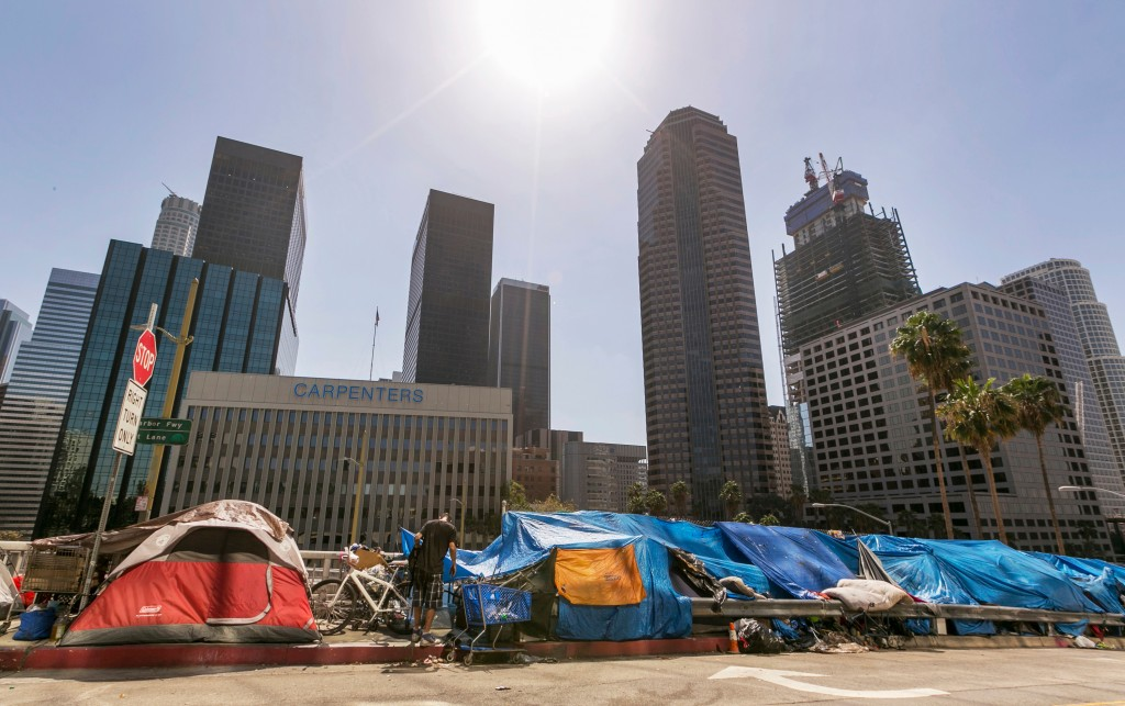 FILE - This Sept. 22, 2015 file photo shows tents used by the homeless lining a downtown Los Angeles street. Los Angeles Mayor Eric Garcetti plans to