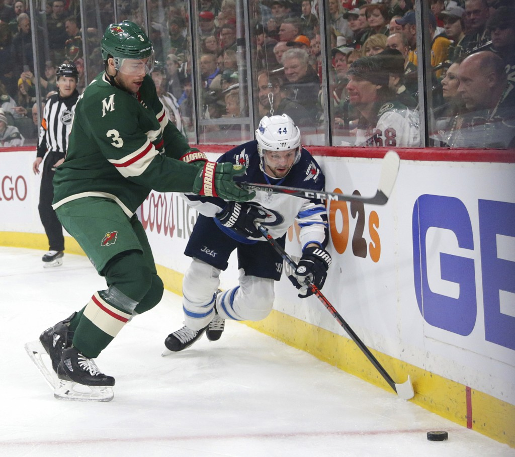 Minnesota Wild center Charlie Coyle (3) defends against Winnipeg Jets defenseman Josh Morrissey (44) in the first period of Game 3 of an NHL first-rou