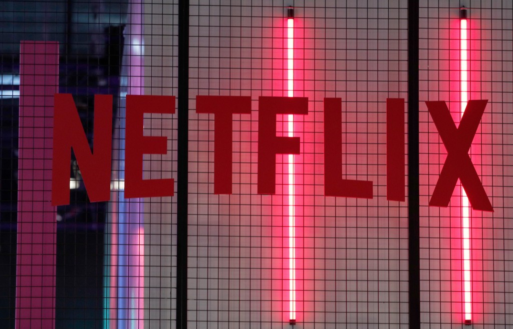 FILE- In this Nov. 4, 2017, file photo, the logo of American entertainment company Netflix is pictured at the Paris games week in Paris. Netflix, Inc.