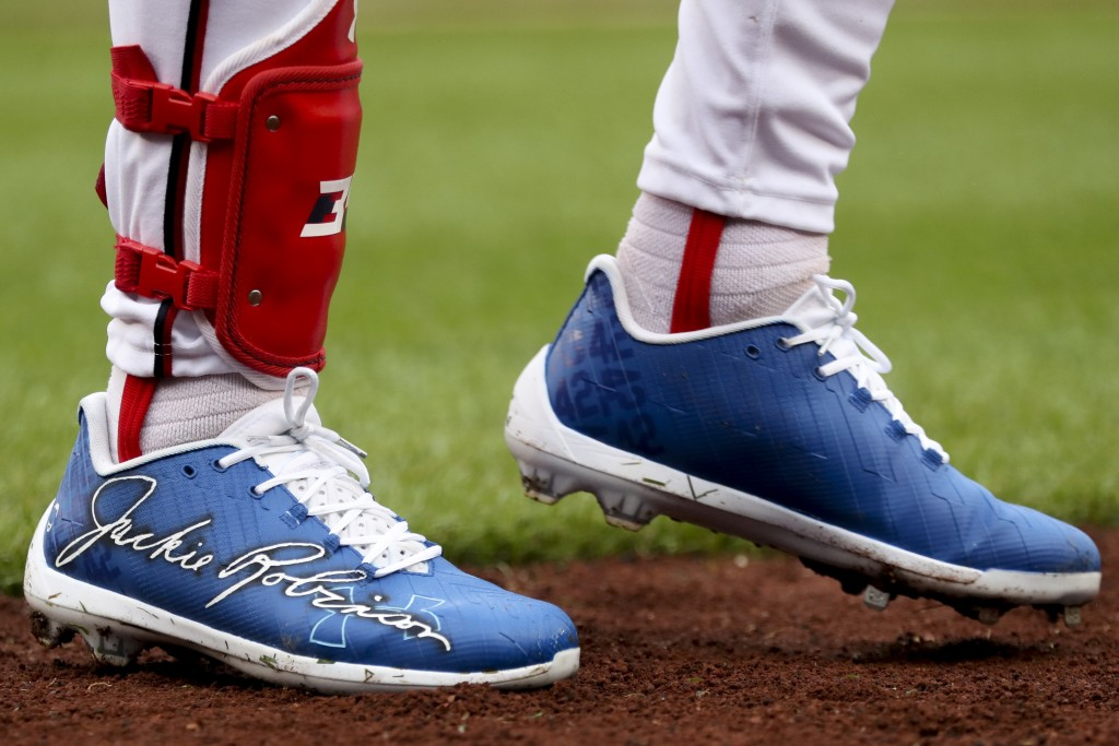 Washington Nationals' Bryce Harper wears shoes with Jackie Robinson's signature for Jackie Robinson Day during a baseball game against the Colorado Ro