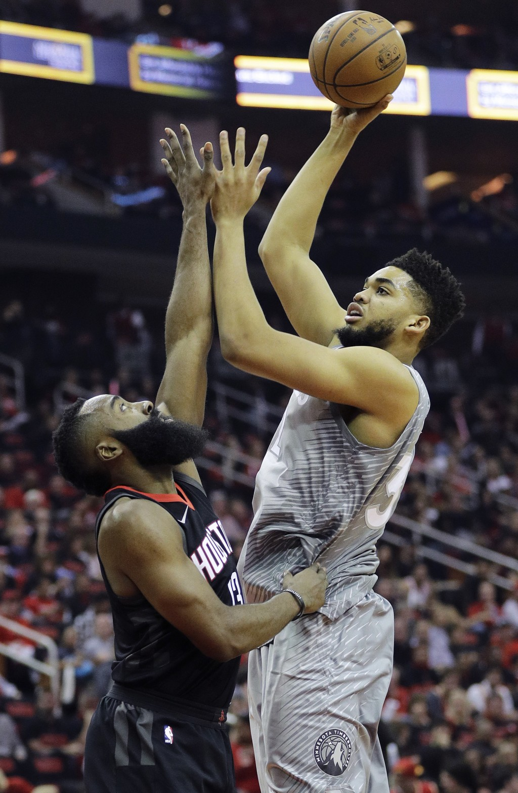 Minnesota Timberwolves' Karl-Anthony Towns shoots over Houston Rockets' James Harden during the first half in Game 1 of a first-round NBA basketball p