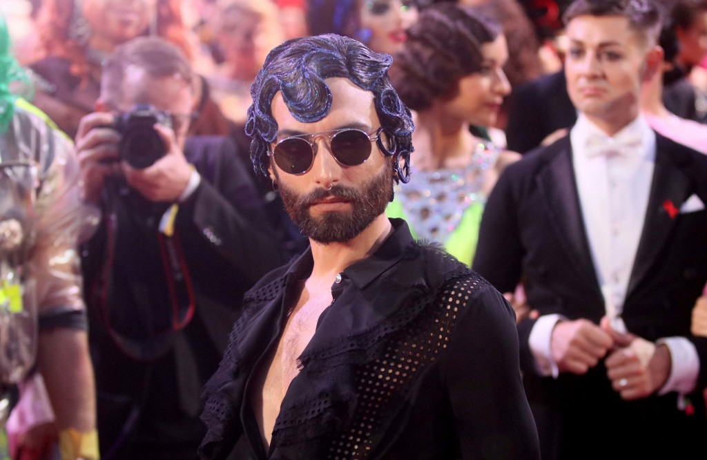 FILE - In this June 10, 2017 file photo Austrian singer Conchita Wurst arrives for the opening ceremony of the Life Ball in front of the City Hall in