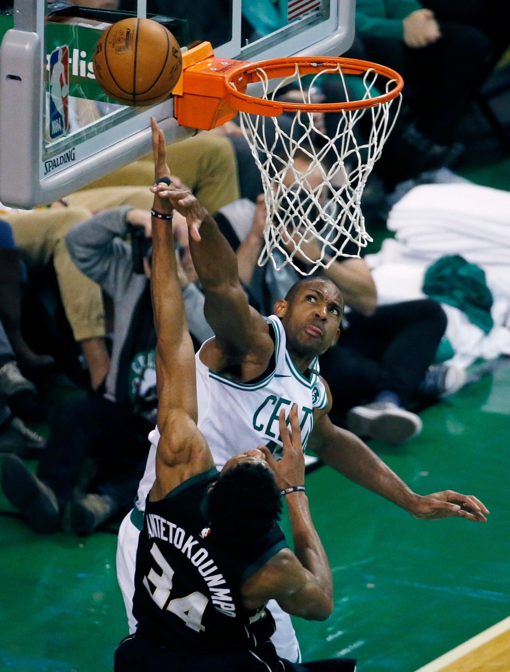 Boston Celtics' Al Horford blocks a shot by Milwaukee Bucks' Giannis Antetokounmpo (34) during the third quarter of Game 1 of an NBA basketball first-