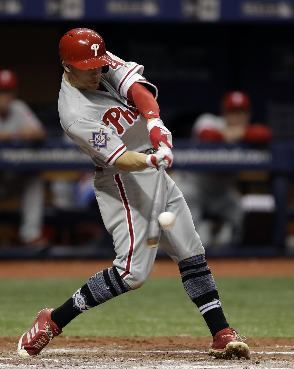 Philadelphia Phillies' Scott Kingery lines a three-run double off Tampa Bay Rays pitcher Ryan Yarbrough during the third inning of a baseball game Sun