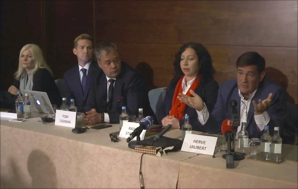 This Thursday, April 12, 2018 image from video, shows Herve Jaubert, right a former  French spy, speaking during a press conference with Radha Stirlin