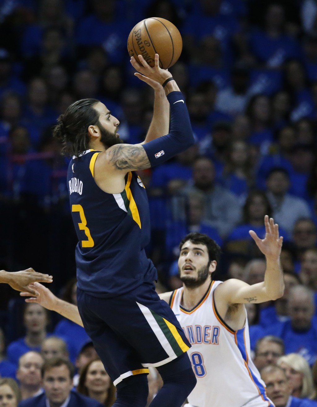 Utah Jazz guard Ricky Rubio (3) shoots in front of Oklahoma City Thunder guard Alex Abrines (8) in the first half of Game 1 of an NBA basketball first