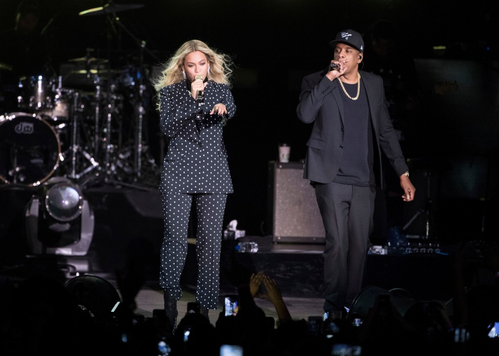 FILE - In this Nov. 4, 2016 file photo, Beyonce, center, and Jay-Z perform during a Democratic presidential candidate Hillary Clinton campaign rally i