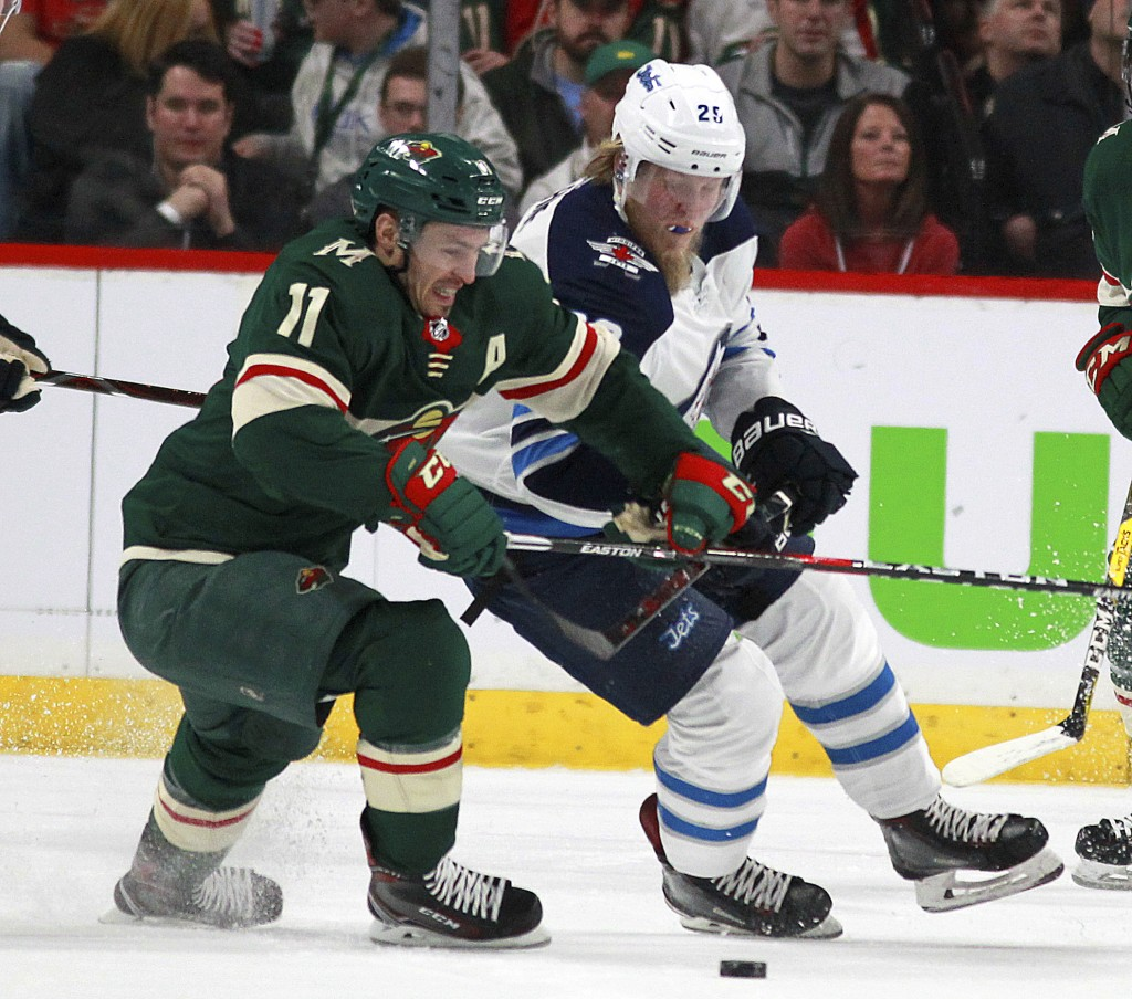 Minnesota Wild left wing Zach Parise (11) battles with Winnipeg Jets right wing Patrik Laine (29) in the first period of Game 3 of an NHL first-round