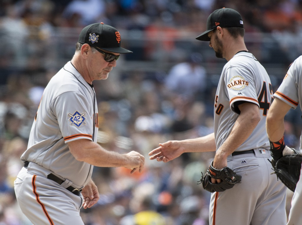 San Francisco Giants manager Bruce Bochy, left, removes starting pitcher Tyler Beede during the fourth inning of a baseball game against the San Diego