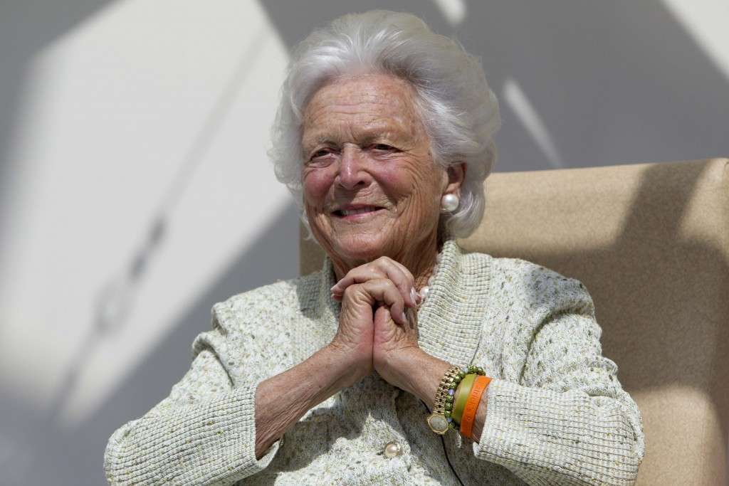 FILE - In a Thursday, Aug. 22, 2013, file photo, former first lady Barbara Bush listens to a patient's question during a visit to the Barbara Bush Chi