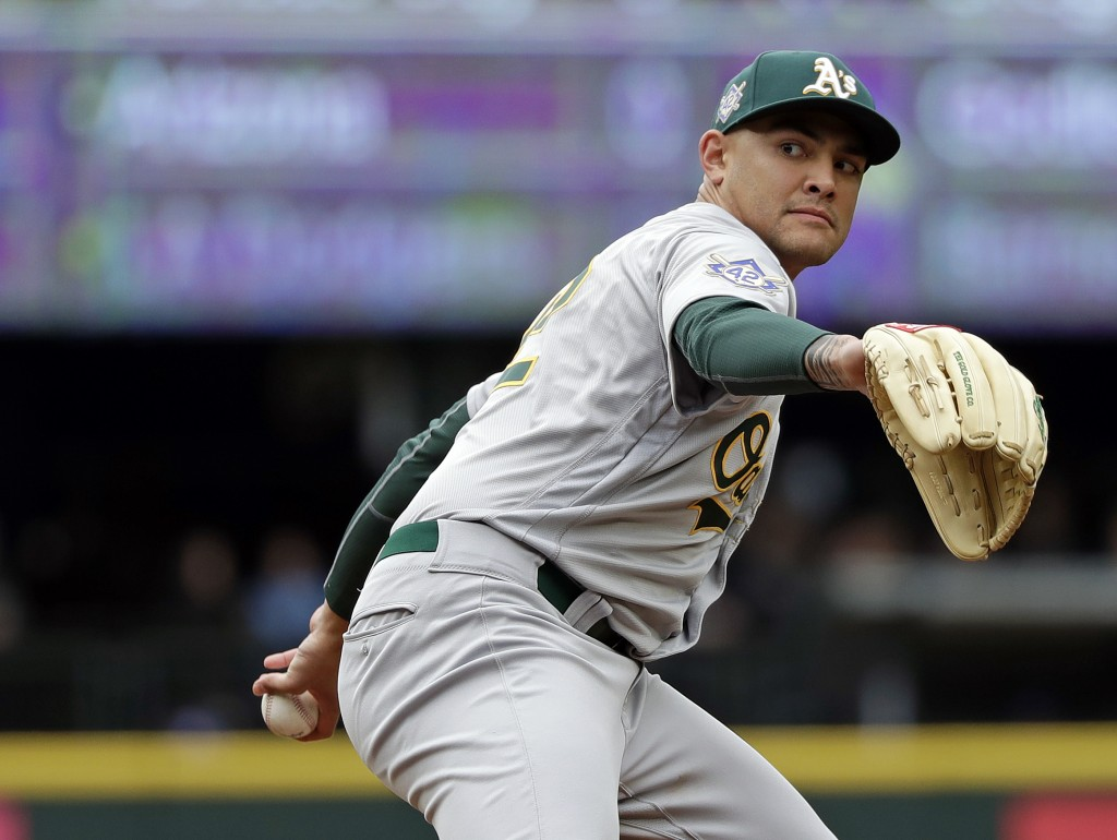 Oakland Athletics starting pitcher Sean Manaea throws against the Seattle Mariners in the second inning during a baseball game Sunday, April 15, 2018,