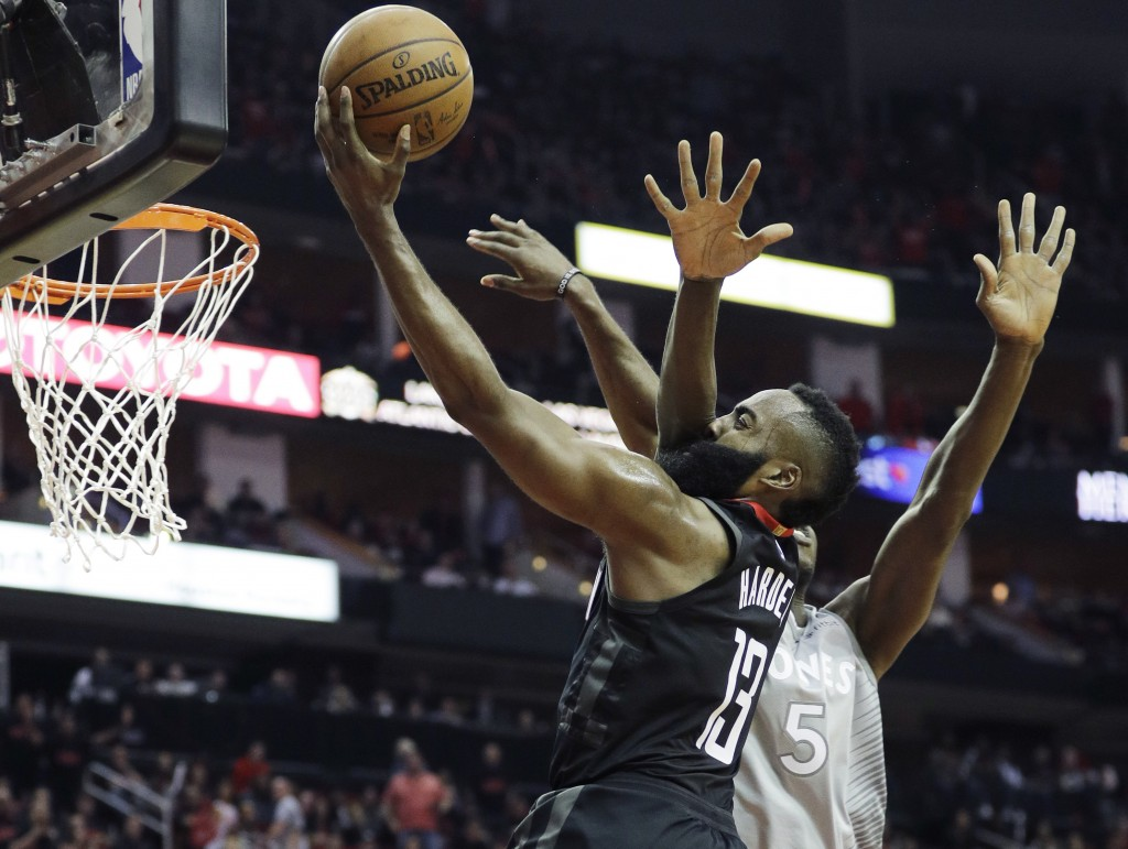 Minnesota Timberwolves' Gorgui Dieng, right, fouls Houston Rockets' James Harden during the second half in Game 1 of a first-round NBA basketball play
