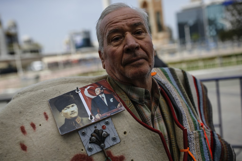 A supporter of Turkey's main opposition Republican People's Party, CHP wearing a jacket decorated with photos of Mustafa Kemal Ataturk, the founder of