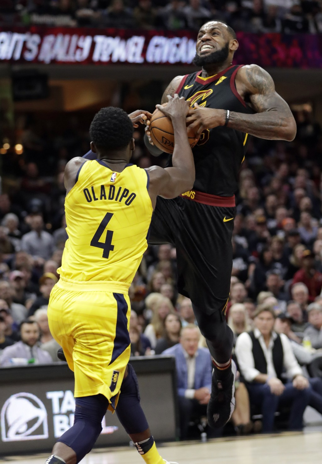 Cleveland Cavaliers' LeBron James (23) drives to the basket against Indiana Pacers' Victor Oladipo (4) in the first half of a first-round playoff seri