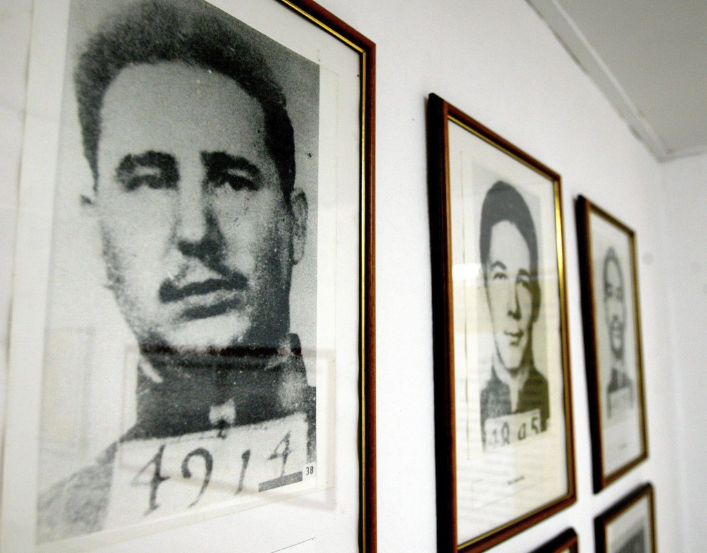 FILE - This July 19, 2003 file photo shows the 1953 mug shots of Fidel Castro, left, and his brother Raul, framed and on display at the Siboney Museum