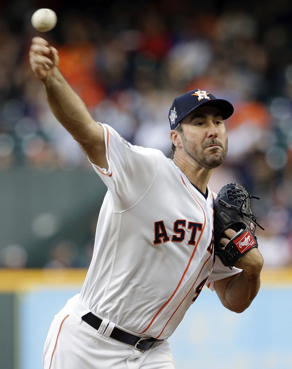 Houston Astros' starting pitcher Justin Verlander throws against the Texas Rangers during the first inning of a baseball game Sunday, April 15, 2018,