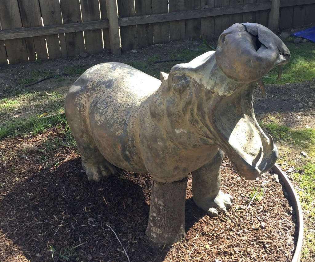 This undated photo provided by Debra Benes shows a hippo statue in Monecito, Calif., that was discovered in the debris from the recent catastrophic Ca
