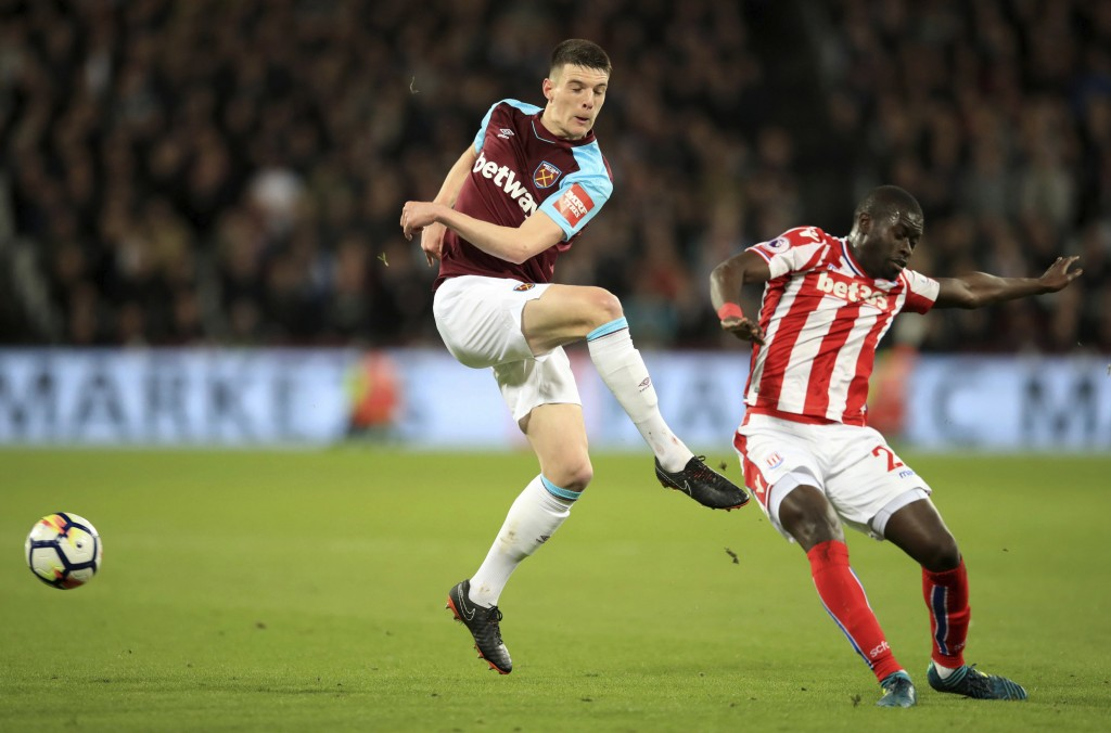 Stoke City's Badou Ndiaye, right, and West Ham United's Declan Rice, during the English Premier League soccer match at London Stadium, Monday April 16