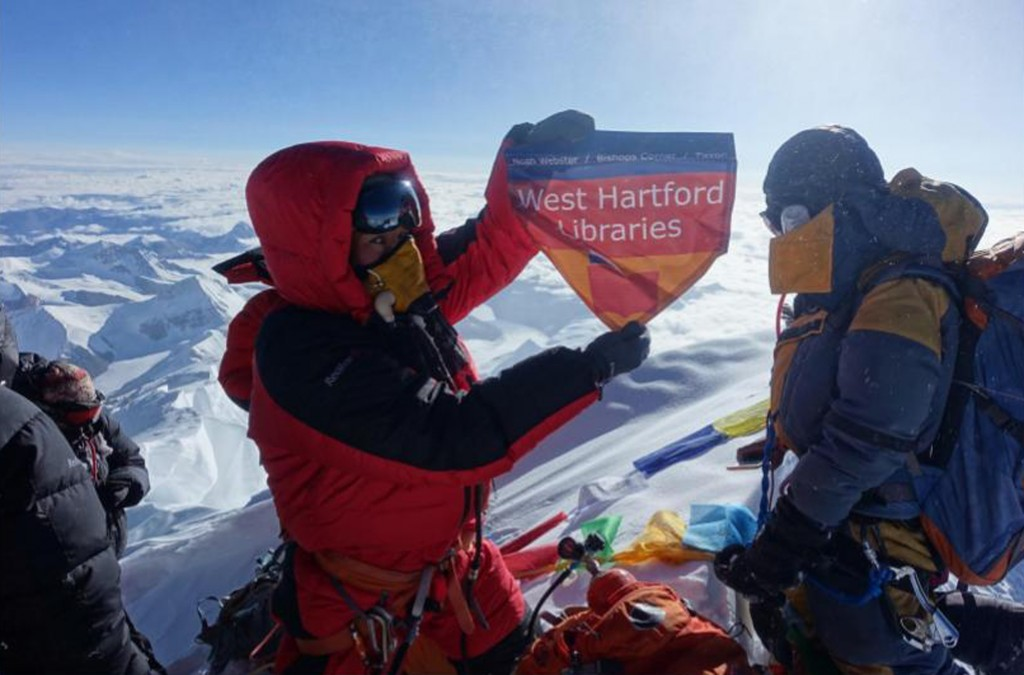 In this May 2017 photo provided by Lhakpa Sherpa, Sherpa displays a flag from West Hartford, Conn., on the summit of Mount Everest in Nepal. Once a ye